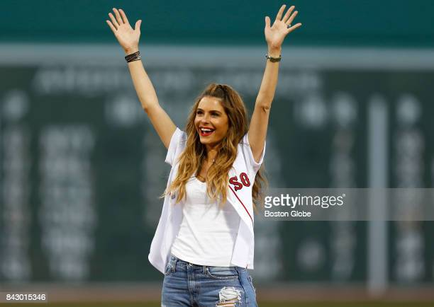Actress and Medford native Maria Menounos throws out the first pitch before the start of the game The Boston Red Sox host the Toronto Blue Jays at...
