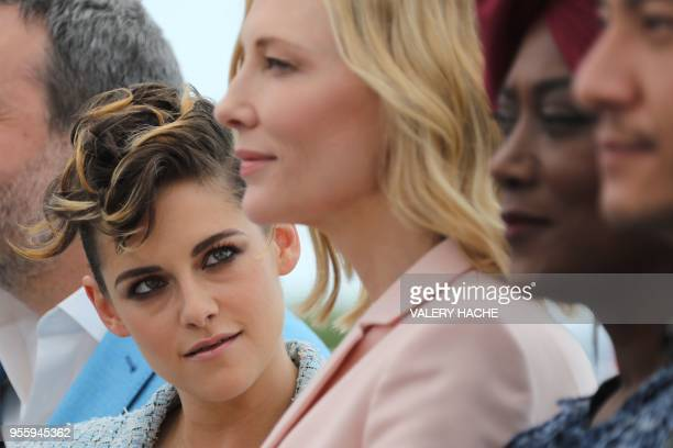 Actress and member of the Feature Film Jury Kristen Stewart looks at Australian actress and President of the Jury Cate Blanchett as they pose on May...