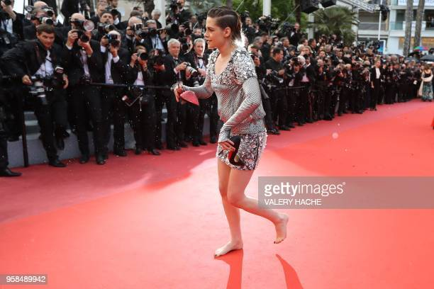 TOPSHOT US actress and member of the Feature Film Jury Kristen Stewart walks barefoot on the red carpet after she removed her shoes as she arrives on...