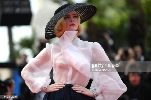TOPSHOT US actress and member of the jury of the Cannes Film Festival Elle Fanning poses as she arrives for the screening of the film Once Upon a...
