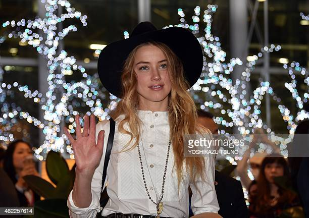 US actress and model Amber Heard accompanied by her fiance US actor Johnny Depp arrives at Tokyo International Airport on January 26 2015 for the...
