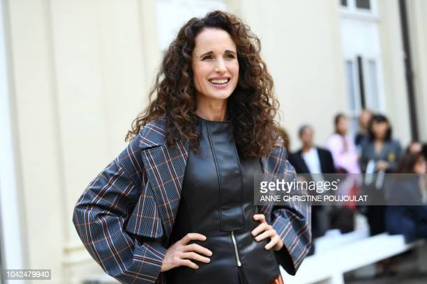 US actress and model Andie MacDowell poses as she arrives for the Cedric Charlier SpringSummer 2019 ReadytoWear collection fashion show in Paris on...