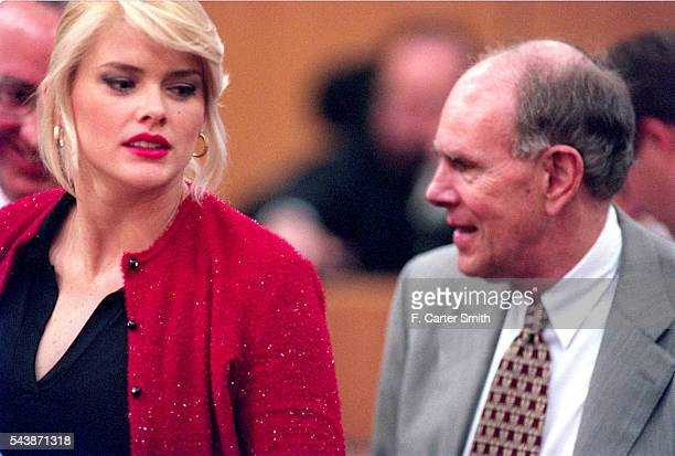 Actress and model Anna Nicole Smith looks over her shoulder at stepson J Howard Marshall II as the probate trial of the estate of her late husband J...