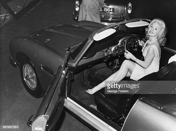 Actress and model Barbara Roscoe at the wheel of the new Aston Martin DB5 car at the Motor Show in Earls Court London October 15th 1963