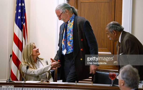 Actress and model Bo Derek greets Dr Patch Adams founder of the Gesundheit Institute during during a health care reform panel discussion with House...