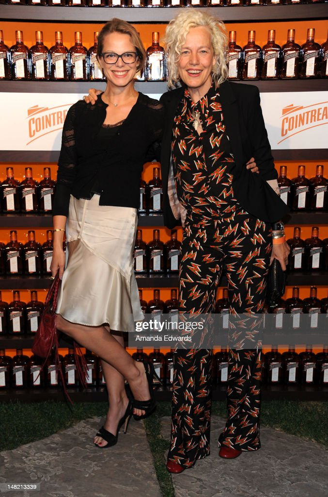 Actress and model Cecile Breccia (L) and photographer Ellen von Unwerth arrive at the Dita Von Teese and Cointreau Launch Cointreau Poolside Soirees event at the Beverly Hills Hotel on July 11, 2012 in Beverly Hills, California.