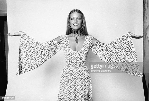 Actress and model Edina Ronay wearing a floral dress with wide sleeves and cut away shoulders 17th August 1970