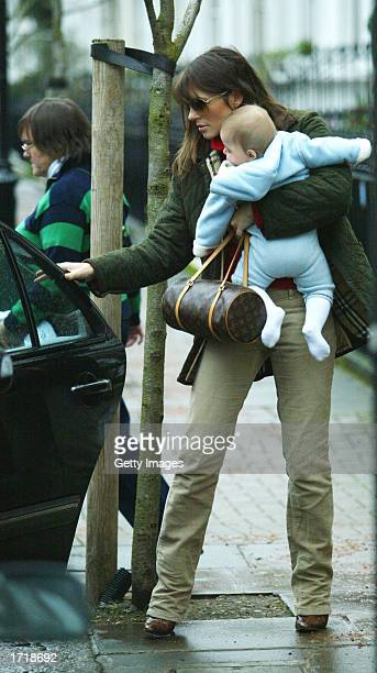 Actress and model Elizabeth Hurley leaves her house with her son Damien January 10 2003 in Chelsea London