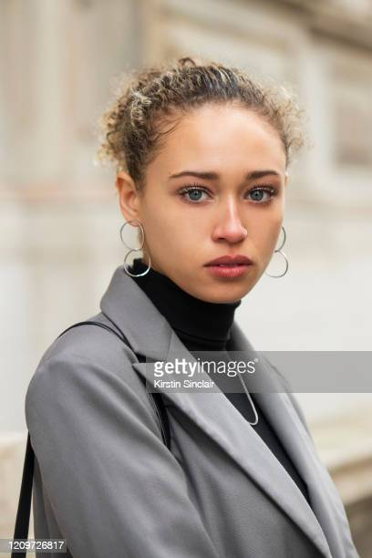 Actress and model Ella Rae Smith wears a Dak's suit and Anthropologie earrings during London Fashion Week February 2020 on February 18 2020 in London...