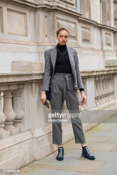 Actress and model Ella Rae Smith wears a Dak's suit Converse trainers Jill Sander bag Vintage necklace and Anthropologie earrings during London...