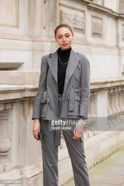 Actress and model Ella Rae Smith wears a Dak's suit Jill Sander bag Vintage necklace and Anthropologie earrings during London Fashion Week February...