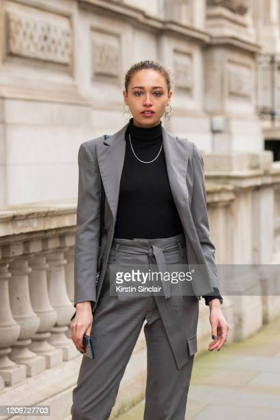 Actress and model Ella Rae Smith wears a Dak's suit Vintage necklace and Anthropologie earrings during London Fashion Week February 2020 on February...