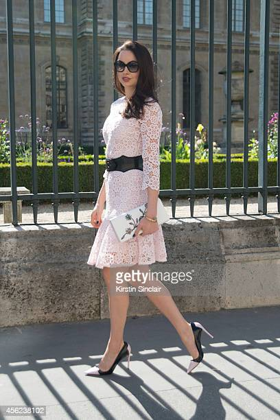 Actress and Model Emma Miller is wearing a Dior dress and shoes and Miu Miu sunglasses on day 4 of Paris Collections Women on September 26 2014 in...