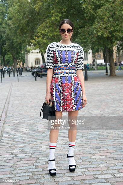 Actress and Model Emma Miller is wearing a Peter Pilotto dress Prada shoes Topshop socks M2 Italia bag and Roberto Cavalli sunglasses on day 4 of...