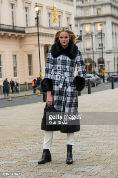 Actress and Model Gabriella Wilde wears a Shrimps coat and bag Jeanerica jeans and black boots during London Fashion Week February 2020 on February...