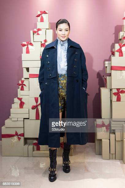 Actress and Model Galie Lok poses for a photograph on the red carpet at the Burberry Pacific Place event on 03 November 2016 in Hong Kong, China.