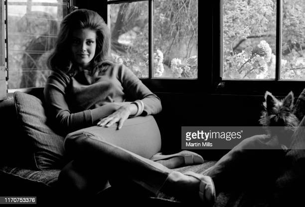 Actress and model Gayle Hunnicutt poses for a portrait with her dog circa 1968 in Los Angeles California
