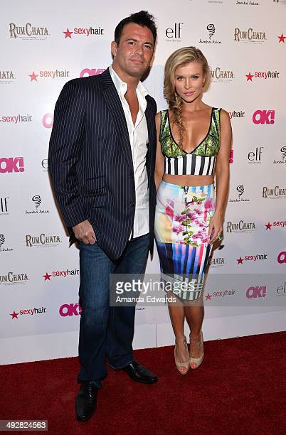 Actress and model Joanna Krupa and her husband Romain Zago arrive OK Magazine's 'So Sexy' LA Event at Lure on May 21 2014 in Hollywood California