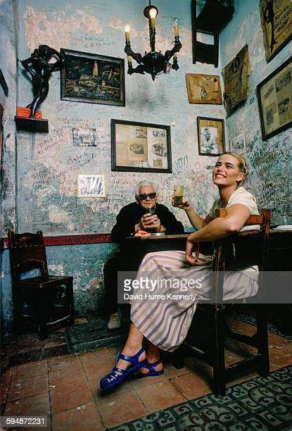 Actress and model Margaux Hemingway and owner Angel Martínez at the restaurant-bar, La Bodeguita del Medio, in February 1978 in Havana, Cuba. The...