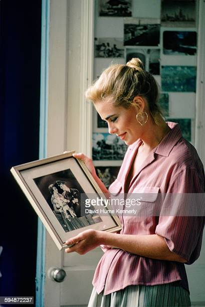 Actress and model Margaux Hemingway looks at a photograph at her grandfather Ernest Hemingway's house February 1978 in Havana Cuba The house known as...
