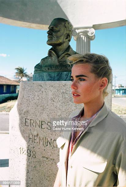 Actress and model Margaux Hemingway stands next to a bust of her grandfather, Ernest Hemingway, February 1978 in the village of Cojimar, Cuba.