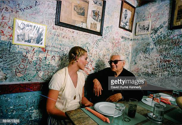 Actress and model Margaux Hemingway talking to owner Angel Martínez at the restaurant-bar, La Bodeguita del Medio, February 1978 in Havana, Cuba. The...