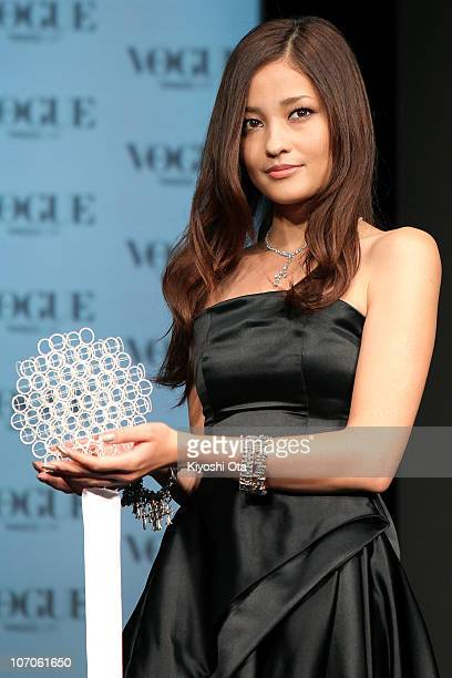 Actress and model Meisa Kuroki is presented an award during the 'Vogue Nippon Women of the Year 2010' award ceremony at Grand Hyatt Tokyo on November...