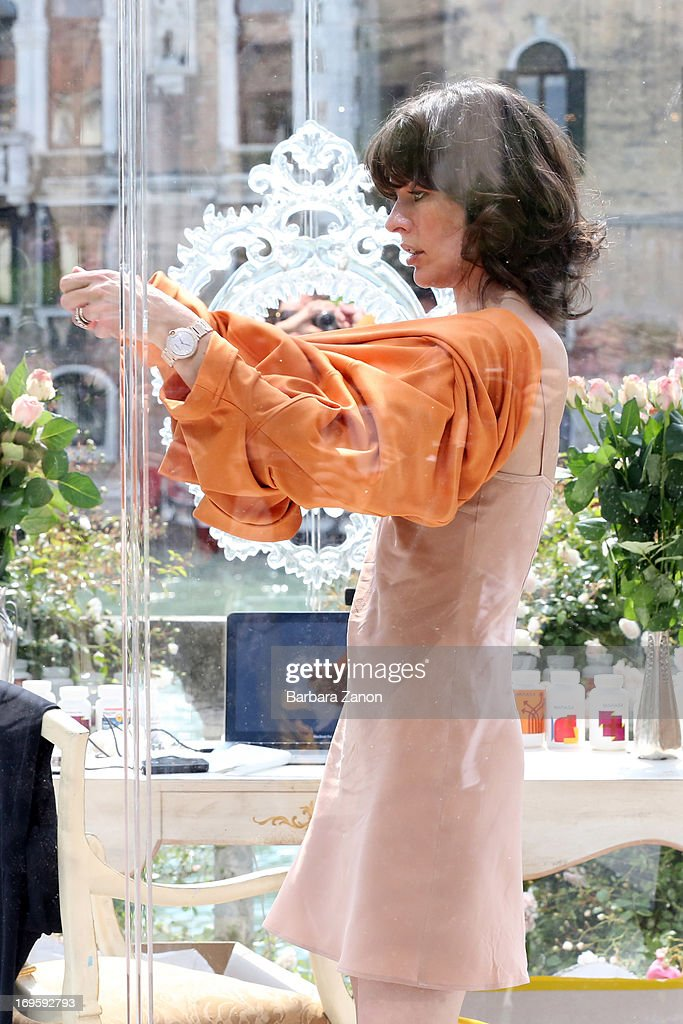 Actress and model Milla Jovovich performs on stage inside a plexiglass cube for Marella during the opening of The 55th International Art Exhibition on May 28, 2013 in Venice, Italy.