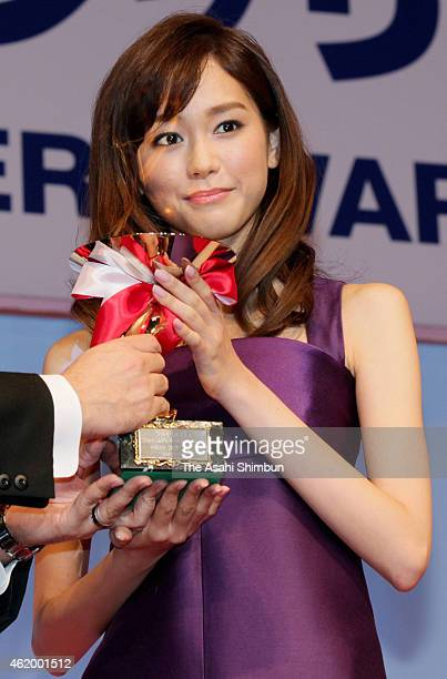 Actress and model Mirei Kiritani receives the trophy of the Japan Best Jewellery Wearer Award Winner for the 20's category during the award ceremony...