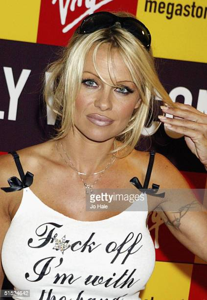 Actress and model Pamela Anderson signs copies of her debut book 'Star A Novel' at Virgin Megastore Piccadilly on October 21 2004 in London The novel...