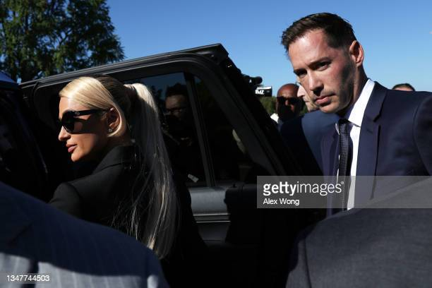 Actress and model Paris Hilton leaves with fiance Carter Reum after a news conference outside the U.S. Capitol October 20, 2021 in Washington, DC....