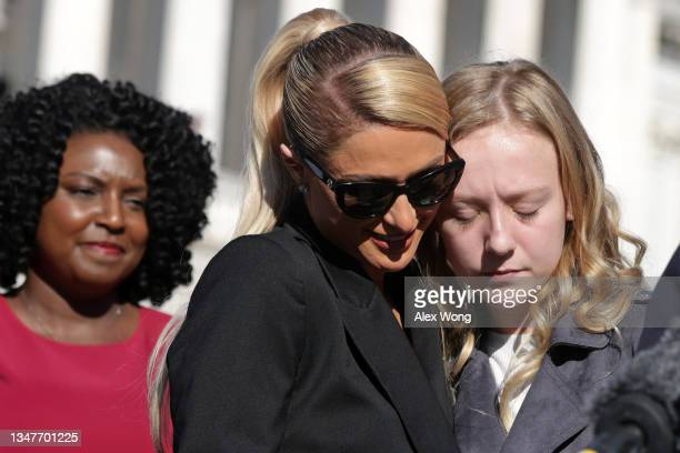 Actress and model Paris Hilton shares a moment with 12-year-old child abuse survivor Uvea Spezza-Lopin of Junction City, Oregon during a news...