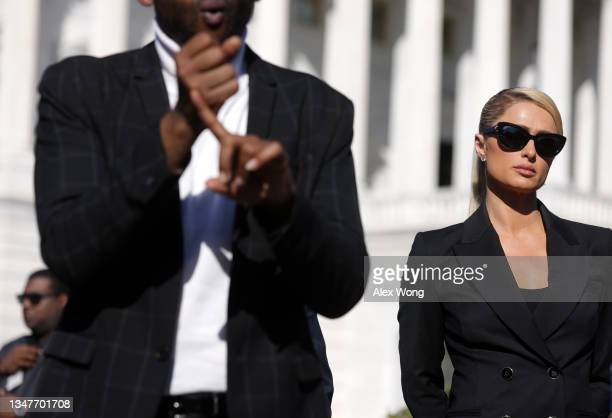Actress and model Paris Hilton waits to be introduced during a news conference outside the U.S. Capitol October 20, 2021 in Washington, DC....