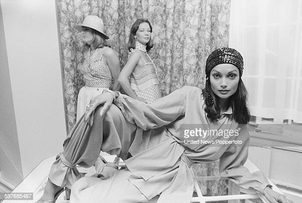 Actress and model Shakira Caine pictured wearing a loose fitting shirt and harem pant style trousers in London on 7th October 1976