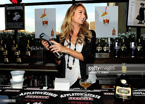 Actress and model Stacy Keibler mixes a cocktail at the Appleton Estate Reserve Remixology Bartender Challenge finals at Hotel Chantelle on September...