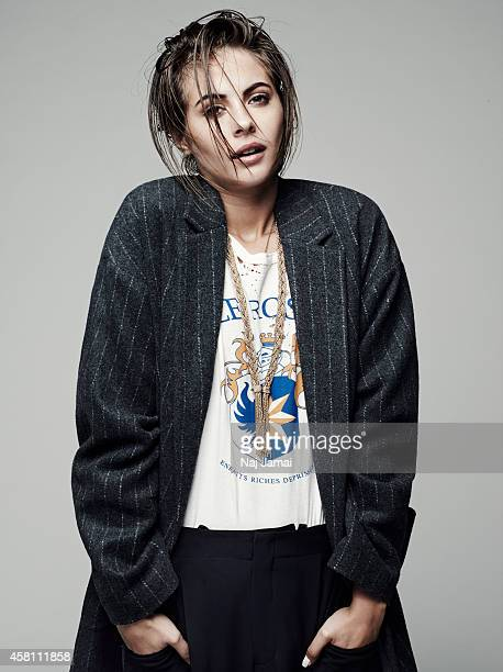 Actress and model Willa Holland is photographed for WhoWhatWearcom on October 8 2014 in Los Angeles California Coat shirt trousers ballet flats and...