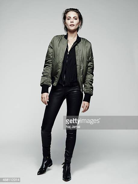 Actress and model Willa Holland is photographed for WhoWhatWearcom on October 8 2014 in Los Angeles California Bomber jacket silk jacket pants...