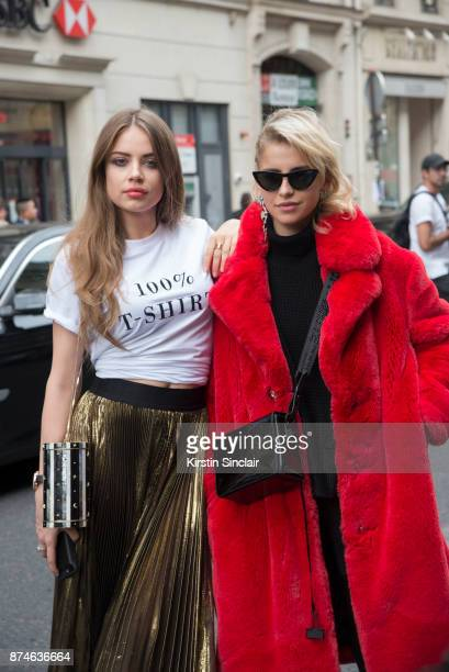Actress and model Xenia Tchoumitcheva wears a Faith Connexion skirt Nathalie Trad bag and Ksenia Schaider Tshirt with German fashion blogger Caroline...