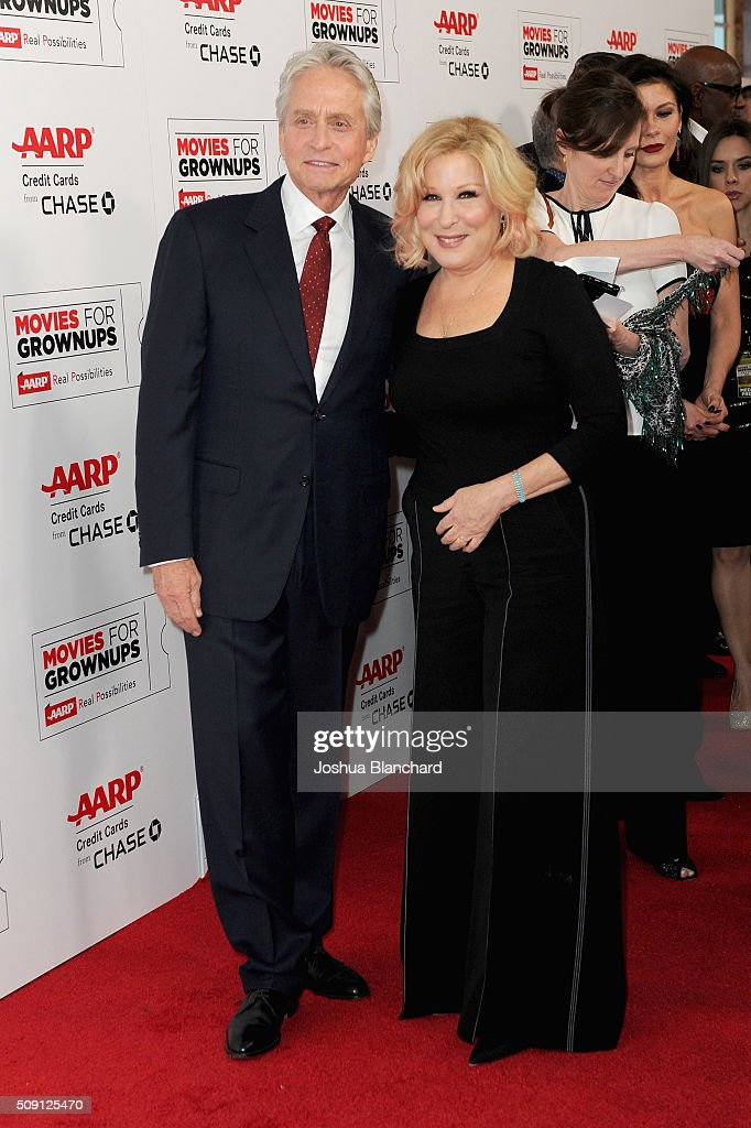 Actress and musician Bette Midler (R) and actor Michael Douglas attend AARP's 15th Annual Movies For Grownups Awards at the Beverly Wilshire Four Seasons Hotel on February 8, 2016 in Beverly Hills, California.