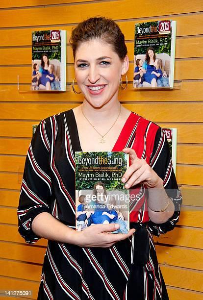 Actress and neuroscientist Mayim Bialik poses before signing copies of her new book 'Beyond The Sling' at Barnes Noble 3rd Street Promenade on March...