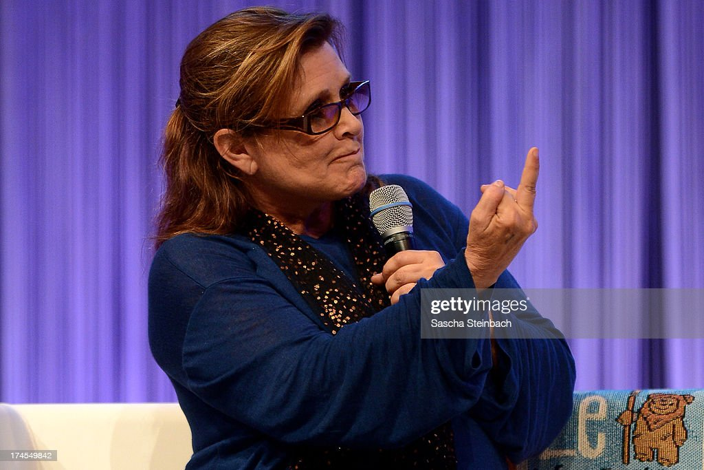 Actress and novelist Carrie Fisher, best known for her performance as Princess Leia in the original Star Wars trilogy, gestures during the Star Wars Celebration at Messe Essen on July 27, 2013 in Essen, Germany.