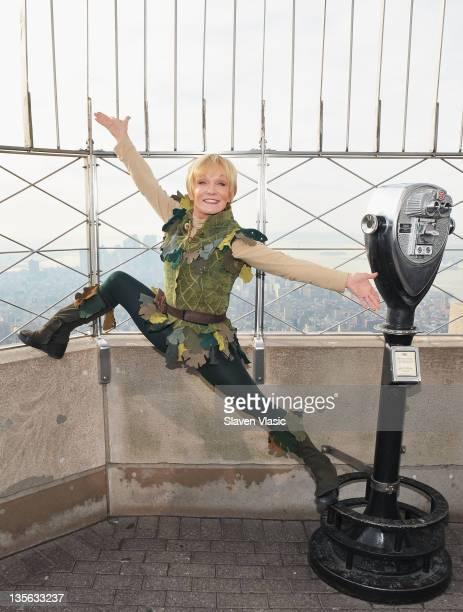 Actress and Olympic gymnast Cathy Rigby as Peter Pan visits The Empire State Building on December 12 2011 in New York City
