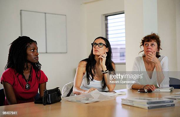 Actress and philanthropist Demi Moore meets with groups working on child slavery as actress Susan Sarandon looks on on April 11 in Port Au Prince...