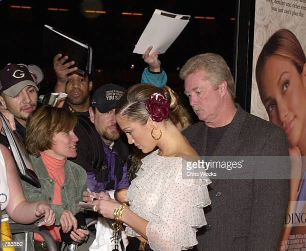 Actress and pop star Jennifer Lopez signs autographs for fans at the premiere of Columbia Pictures'' The Wedding Planner January 23 2001 at Loews...