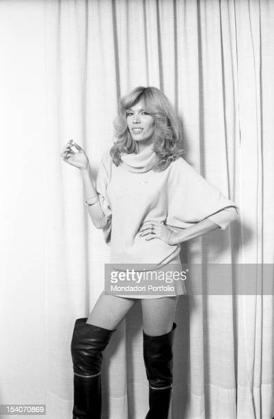 Actress and presenter Amanda Lear wearing boots and a miniskirt 1977