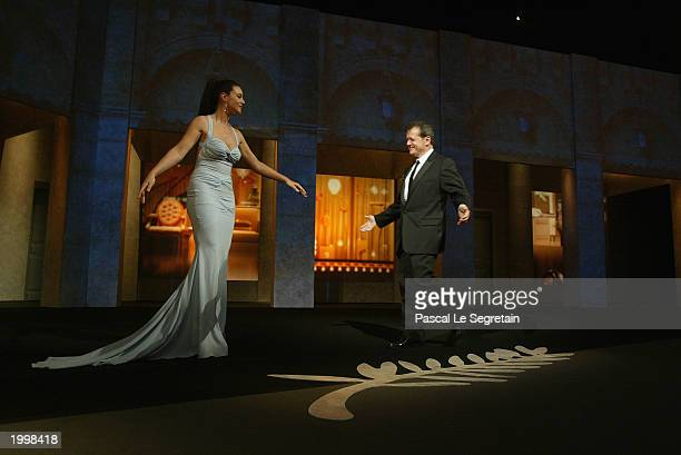 Actress and presenter for the opening ceremony Monica Bellucci welcomes the President of the Jury Patrice Chereau during the Opening Ceremony of the...