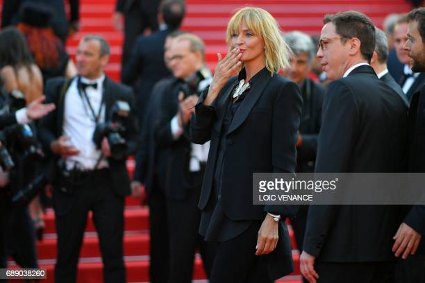 US actress and President of the Un Certain Regard jury Uma Thurman blows kisses as she arrives on May 27 2017 with French actor and member of the Un...
