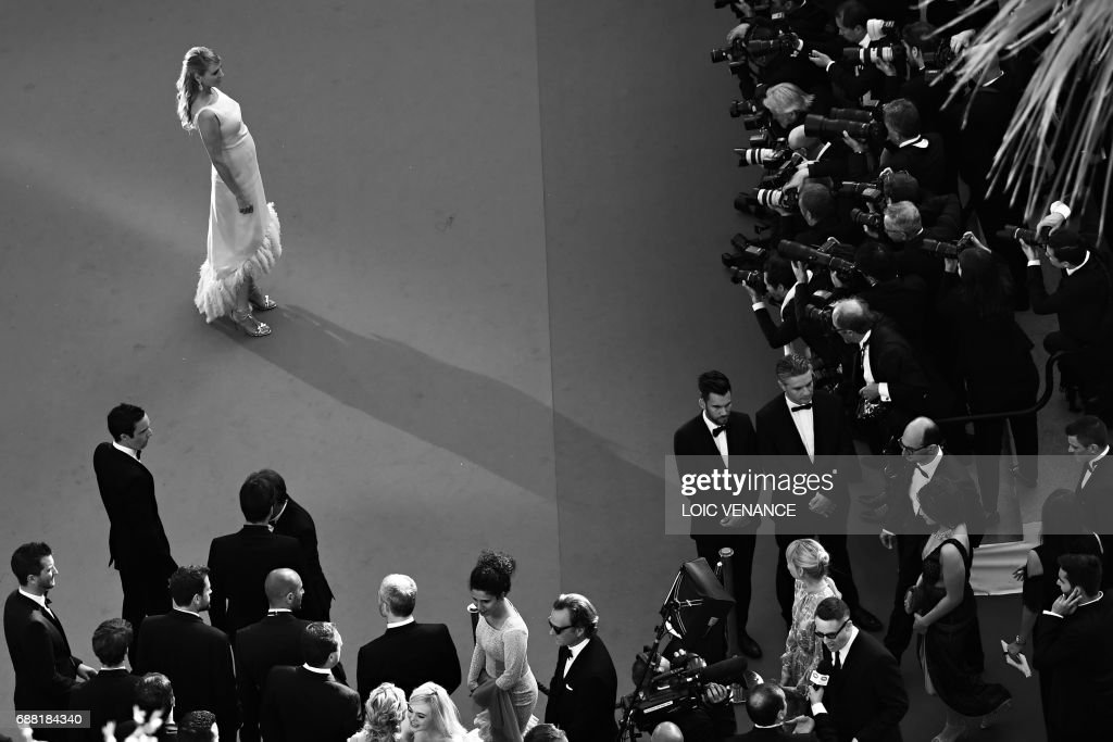 US actress and President of the Un Certain Regard jury Uma Thurman poses as she arrives on May 23, 2017 for the '70th Anniversary' ceremony of the Cannes Film Festival in Cannes, southern France. /