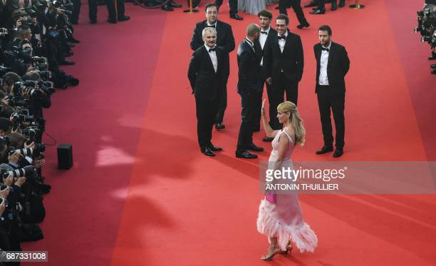 Actress and President of the Un Certain Regard jury Uma Thurman waves as she arrives on May 23, 2017 for the '70th Anniversary' ceremony of the...