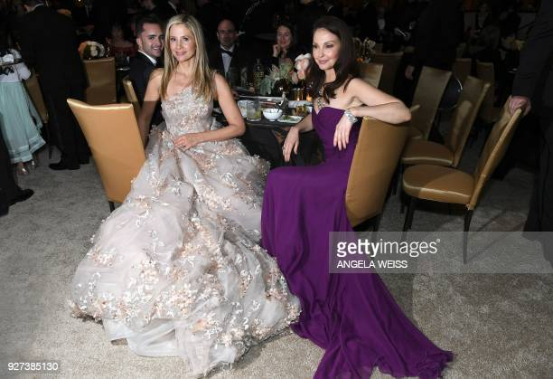 US actress and producer Mira Sorvino and US actress Ashley Judd sit at a table during the 90th Annual Academy Awards on March 4 in Hollywood...